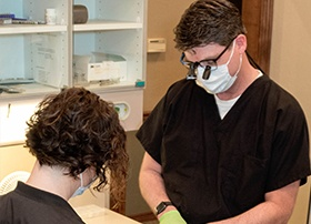 Dr. Lively and team member treating dental patient