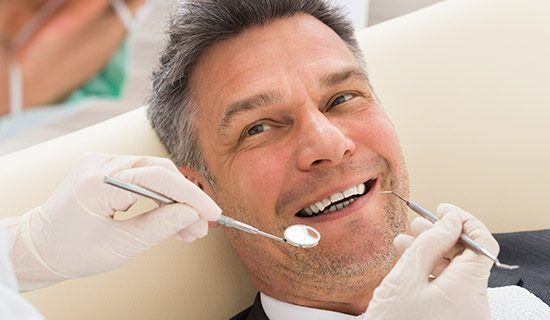 Closeup of smiling man during dental exam