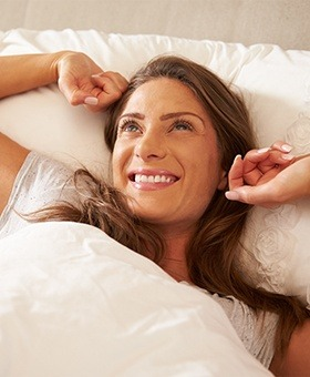 Smiling woman waking feeling refreshed
