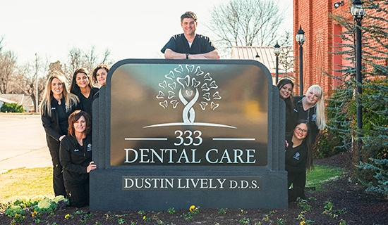 333 Dental Care team members posing at sign